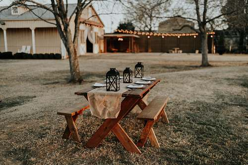 chair rectangular brown wooden picnic table on the field furniture