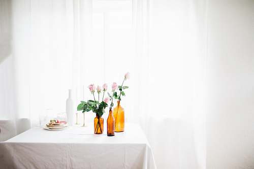 photo linen three amber glass flower vase with pink flowers on white table near window curtain home decor free for commercial use images