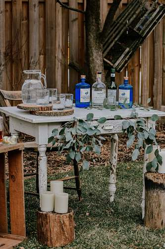 pot white wooden table with bottles on top liquor