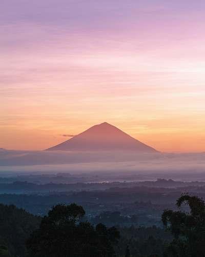 sunrise mountain under orange sky bali