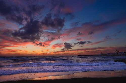 sunrise ocean waves near seashore during golden hour sky