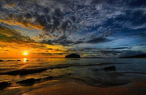 water sunset under beach sea