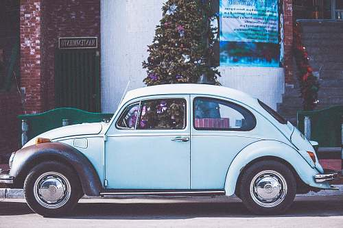 vintage white car near Christmas tree