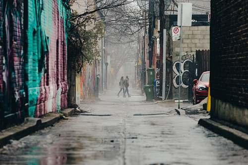 graffiti two women walking on alley alley