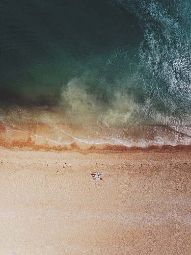 water aerial photography of shore sea