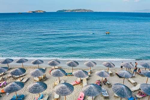 umbrella beach lounge on seashore facing the sea greece