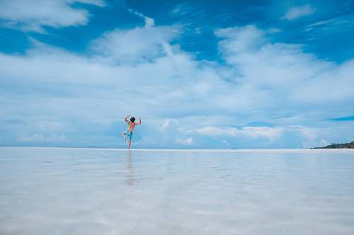 water person standing in body of water man