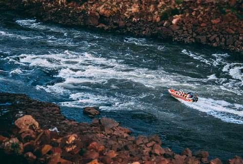 transportation people riding boat on lake during daytime vehicle