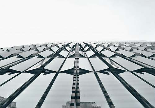 architecture low angle photography of clear glass architectural design skyscraper