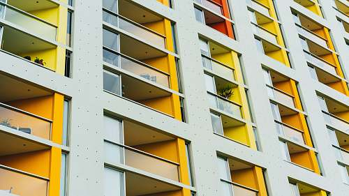 balcony yellow and white city building architecture