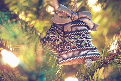 holiday brown bell hanging on christmas tree ornament