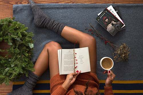 reading opened book on person's lap with gray socks book