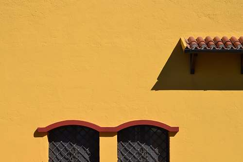 yellow yellow and red painted wall window