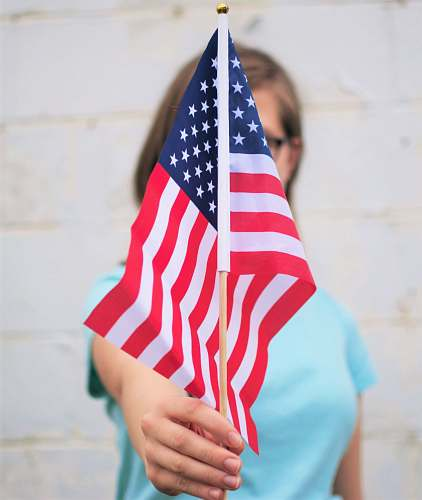 red person holding USA Flag america