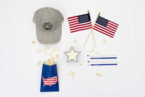 popcorn two U.S.A. flaglets with gray fitted cap and popcorn snack