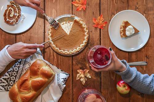 bowl person slicing pie beside bread thanksgiving