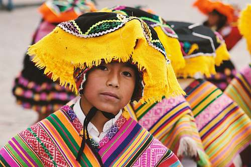 person boy in traditional costume in shallow focus photography people