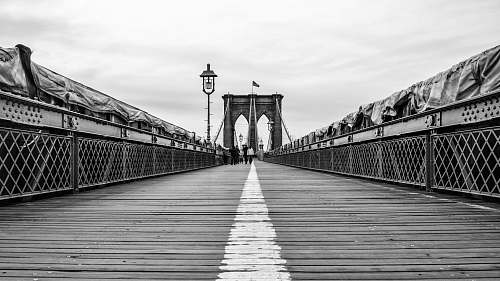 person people walking on bridge black-and-white