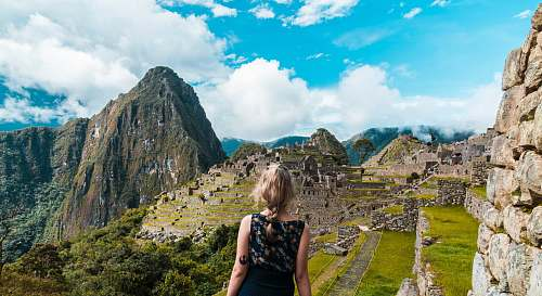 person woman facing Machu Picchu people