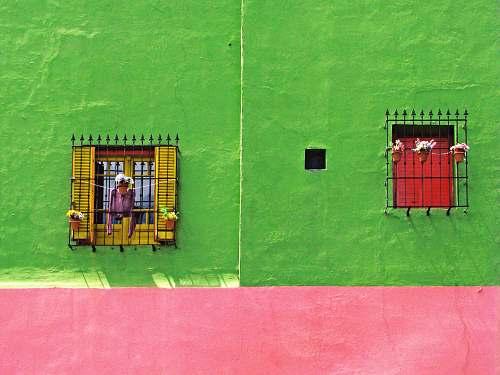person yellow and green concrete building la boca