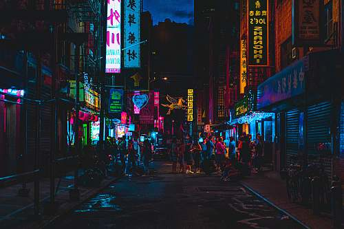 neon people gathering near outdoor during nighttime city