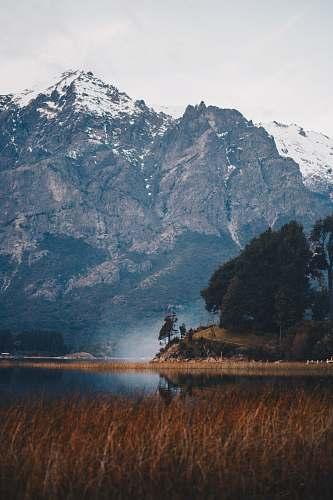 field body of water near mountain bariloche