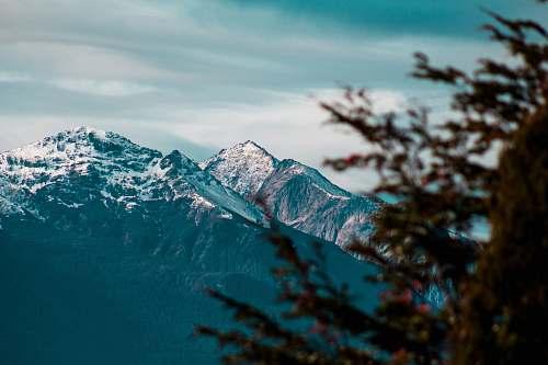 nature white glacier mountain during day time mountain range