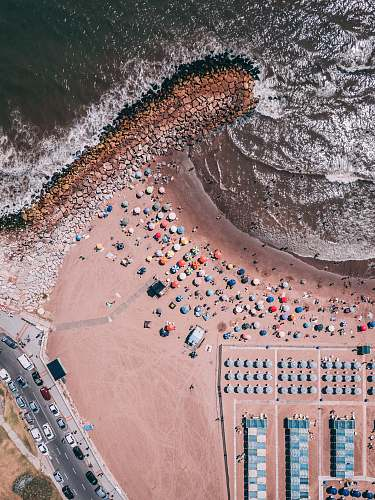 outdoors aerial photography of people near ocean aerial view