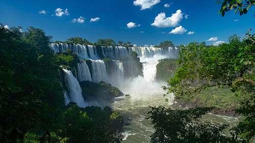 outdoors trees beside waterfalls water