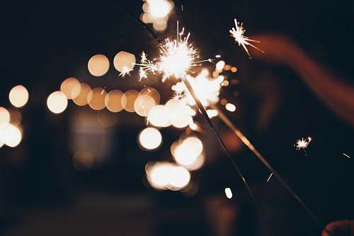 person bokeh photography of sparkler human