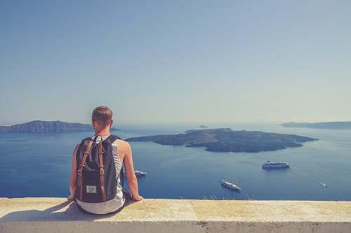 person man sitting facing island human