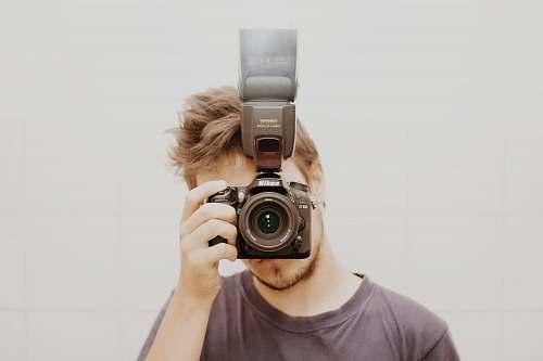human man taking a mirror shot photo people