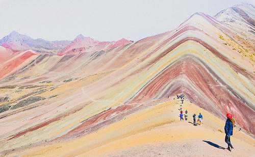 cusco people walking on the mountains during daytime photography rainbow mountain peru