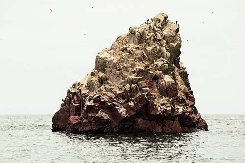 ocean rocky formation near the body of water rock