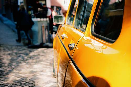 cab yellow car beside street car