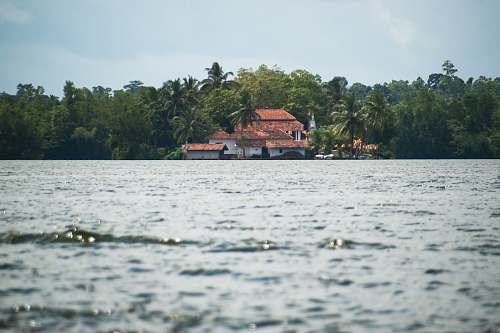 building white and brown house on island water