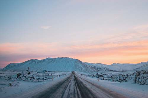snow landscape photography of snow covered road and mountain iceland