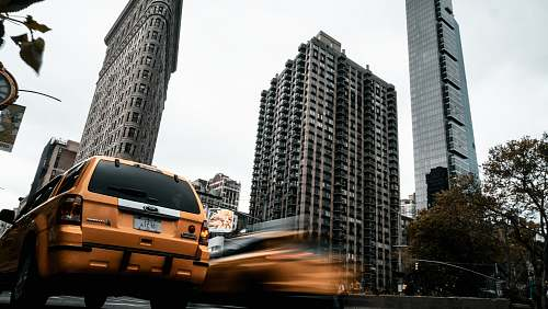 car time lapse photography of cars near buildings transportation