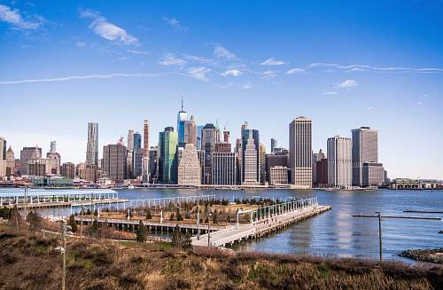 water aerial photography of New York City skyline during daytime waterfront