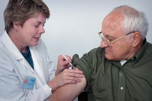 person woman injecting syringe on mans arm accessory