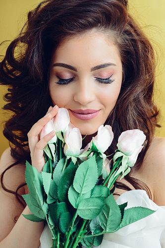 woman touching white rose bouquet