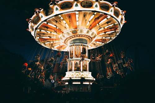theme park people riding revolving carnival ride during night chandelier