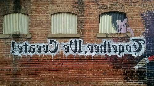 brick white and black Together We Create graffiti wall decor words