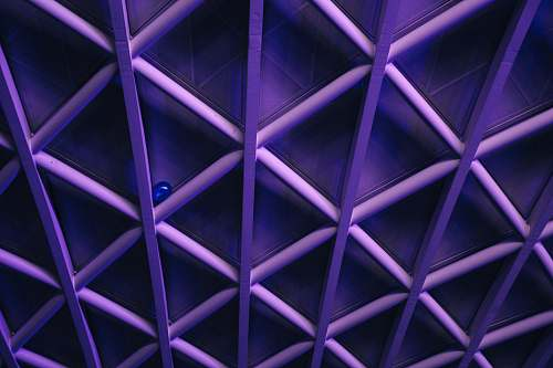 pattern A violet ceiling with a criss-cross pattern; a blue balloon is stuck in the corner one of the crossbars purple