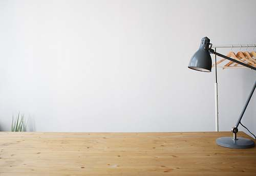 photo desk gray balanced-arm lamp on brown wooden table wood free for commercial use images
