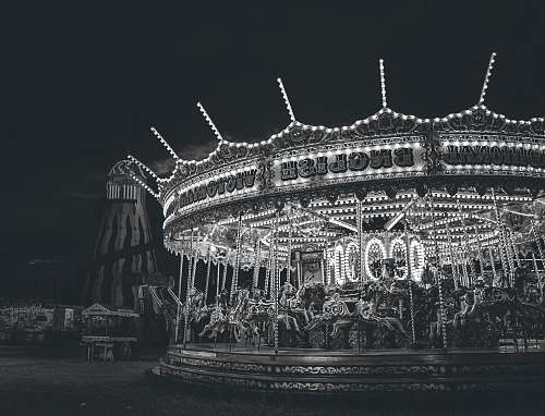 carousel grayscale photo of carousel arena