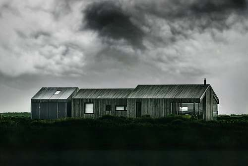 rural grayscale photo of wooden barn outdoors