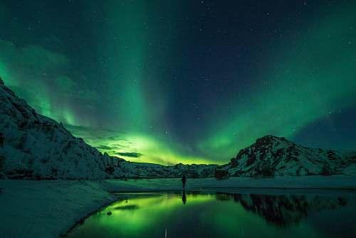 nature snow mountain with Aurora borealis aurora