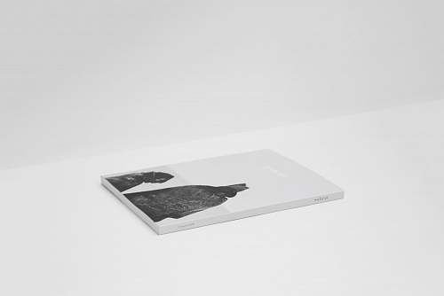 black-and-white book on top of white surface minimal