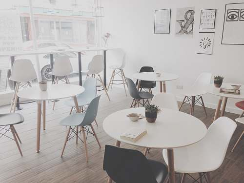 chair minimalist photography of white table and chairs resto table